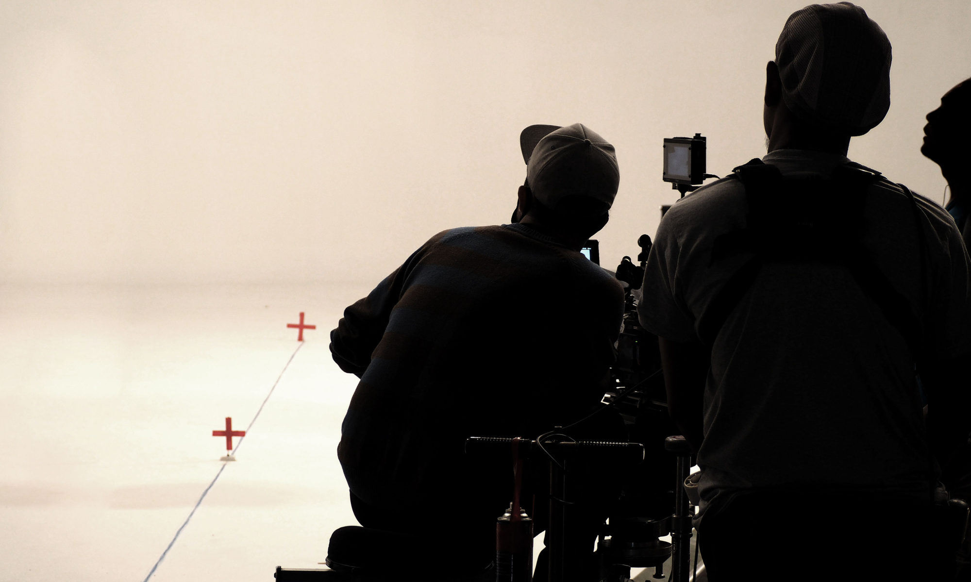 71502840 - behind the scenes or making of film in the studio and silhouette of camera man.